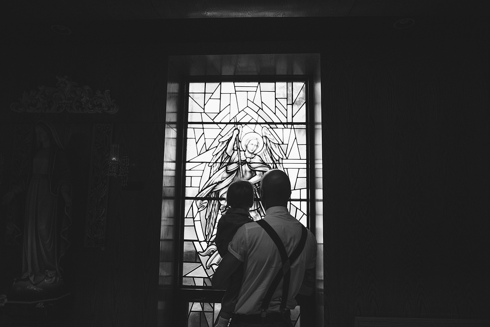 Dad and son silhouette with stain glass at Toronto Wedding