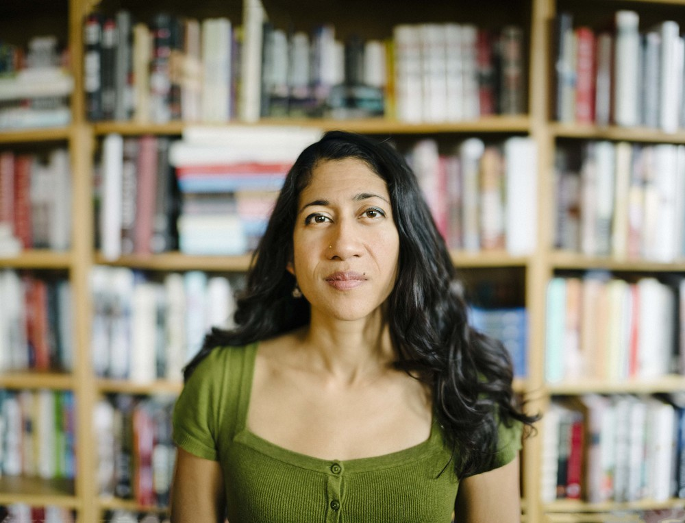 Author and Scotiabank Giller Prize nominee Padma Viswanathan poses for a photograph inside the Penguin Publishing House library - The Globe and Mail