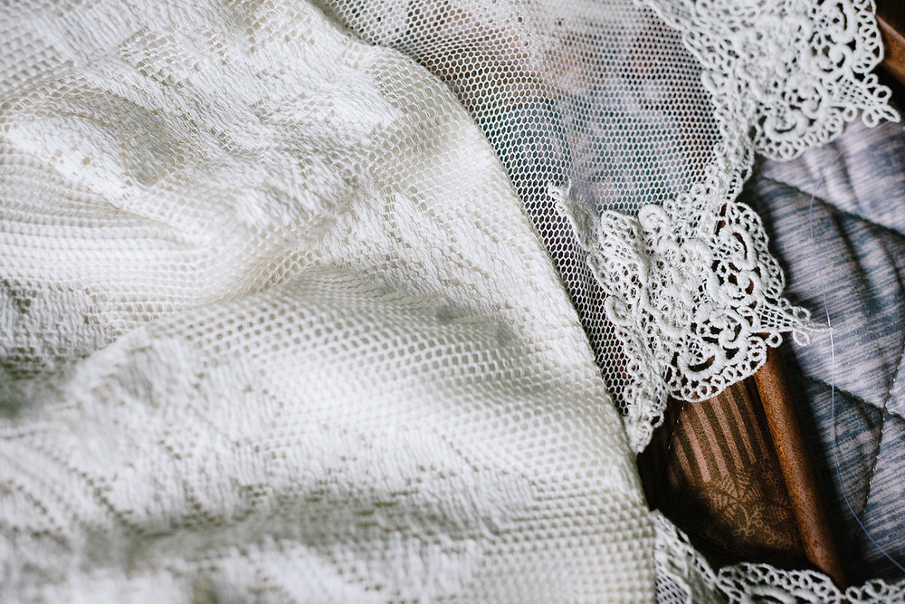 detail of bride's vintage lace wedding dress so stunning
