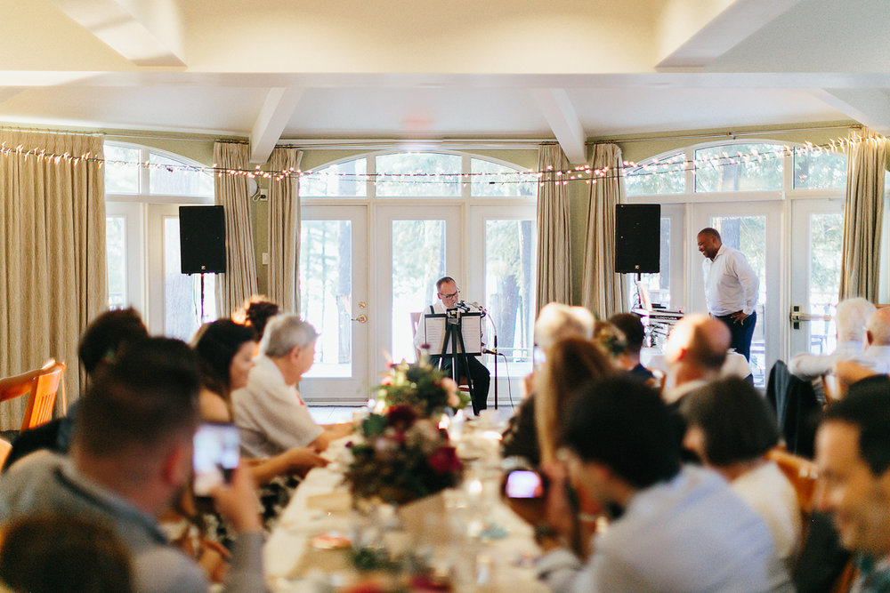 Toronto-Wedding-Photography-Muskoka-Wedding-Lakeside-Forest-Theme-Boho-Bride-intimate-elopement-reception-dad-playing-ukelele.jpg