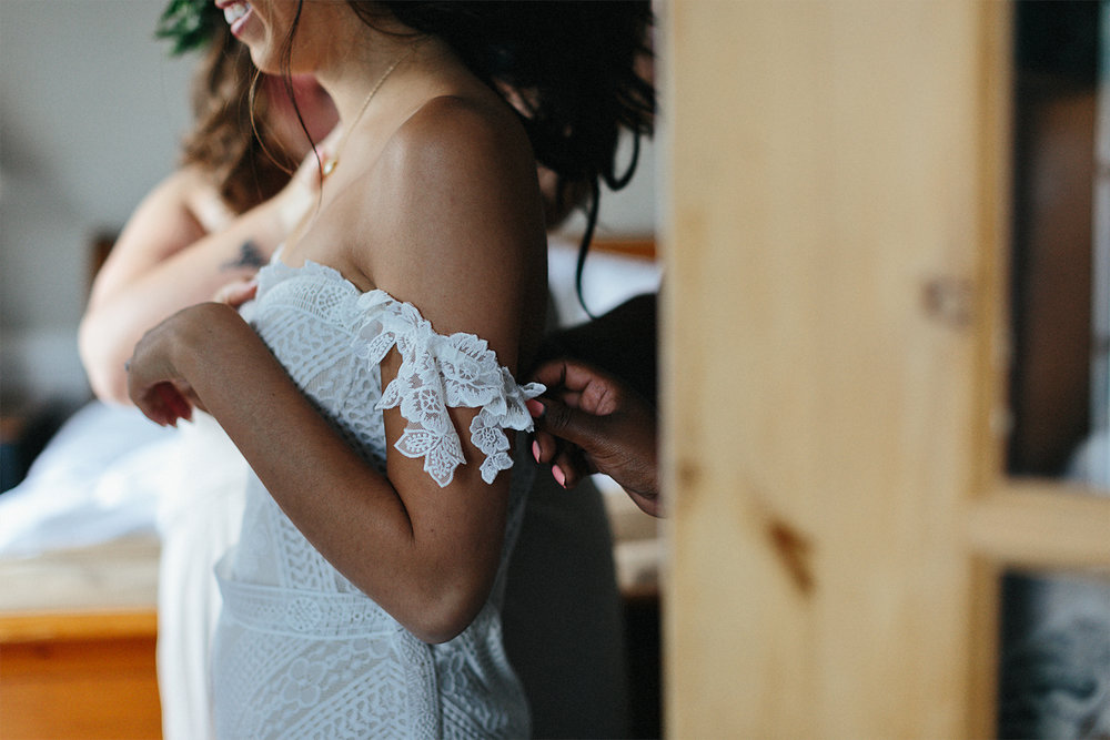 Toronto-Wedding-Photographer-Muskoka-Wedding-Lakeside-Forest-Theme-Boho-Bride-Vintage-wedding-getting-ready-dress-detail.jpg