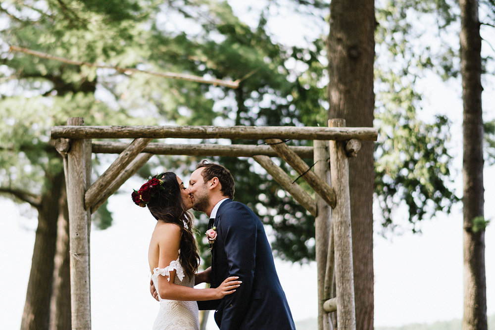 Muskoka-Cottage-Wedding-Photography-Photographer_Photojournalistic-Documentary-Wedding-Photography_Vintage-Bride-Forest-Wedding-Ceremony-Venue-First-Kiss-Bride-and-Groom.jpg