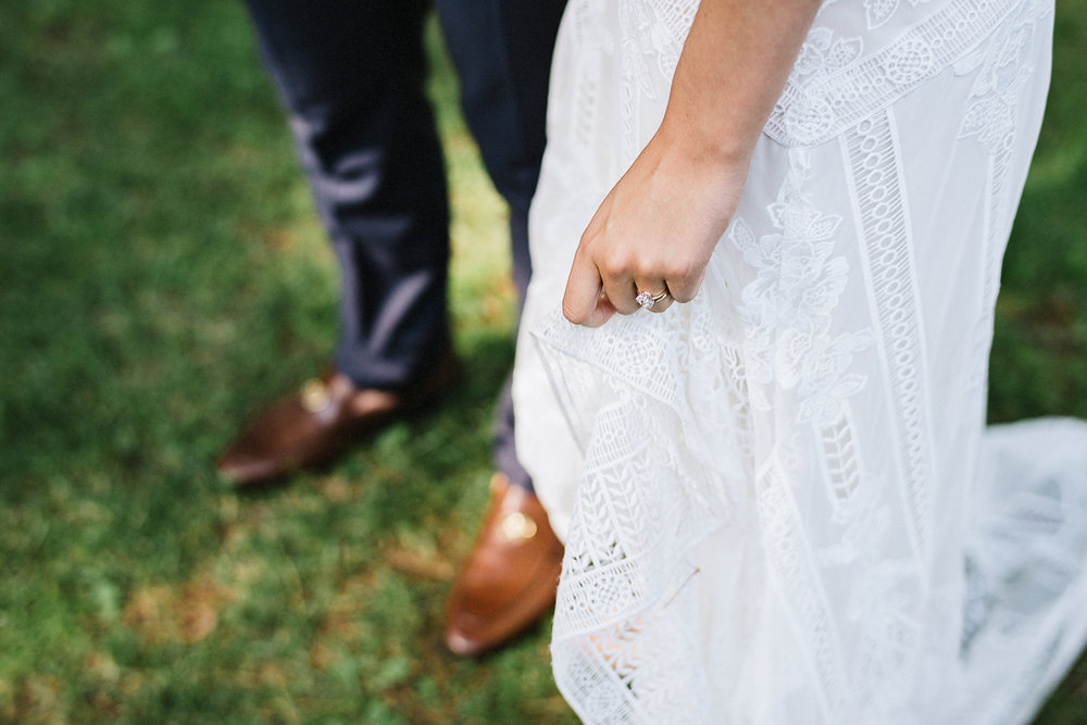 Muskoka-Cottage-Wedding-Photography-Photographer_Photojournalistic-Documentary-Wedding-Photography_Vintage-Bride-Lovers-Land-Dress_Rue-Des-Seins_Bridal-Portrait-Boho-bride-hand-dress-details.jpg
