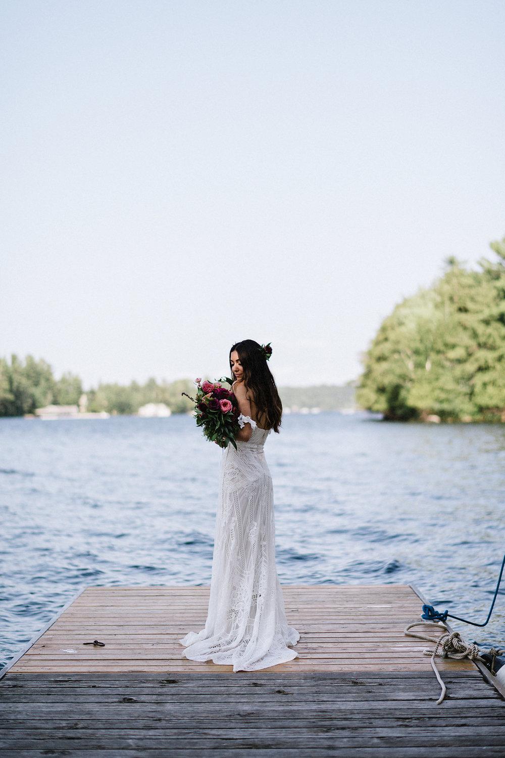 Muskoka-Cottage-Wedding-Photography-Photographer_Photojournalistic-Documentary-Wedding-Photography_Vintage-Bride-Lovers-Land-Dress_Rue-Des-Seins_Bridal-Portrait-Boho-bride-Toronto-Bride-by-lakeside.jpg