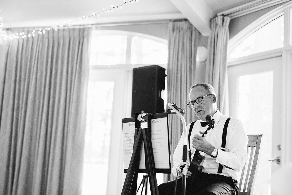 Muskoka-Cottage-Wedding-Photography-Photographer_Photojournalistic-Documentary-Wedding-Photography_Vintage-Bride-Lovers-Land-Dress_Nature_Film_Sherwood-Inn-Reception-Venue-Dad-playing-Ukelele.jpg