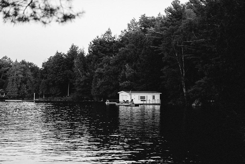 Muskoka-Cottage-Wedding-Photography-Photographer_Photojournalistic-Documentary-Wedding-Photography_Vintage-Bride-Lovers-Land-Dress_Sunset-Boathouse-Detail-sunset.jpg