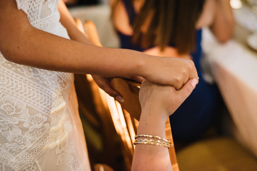 Muskoka-Cottage-Wedding-Photography-Photographer_Photojournalistic-Documentary-Wedding-Photography_Vintage-Bride-Lovers-Land-Dress_Nature_Film_Sherwood-Inn_Bride-hand-holding-detail.jpg