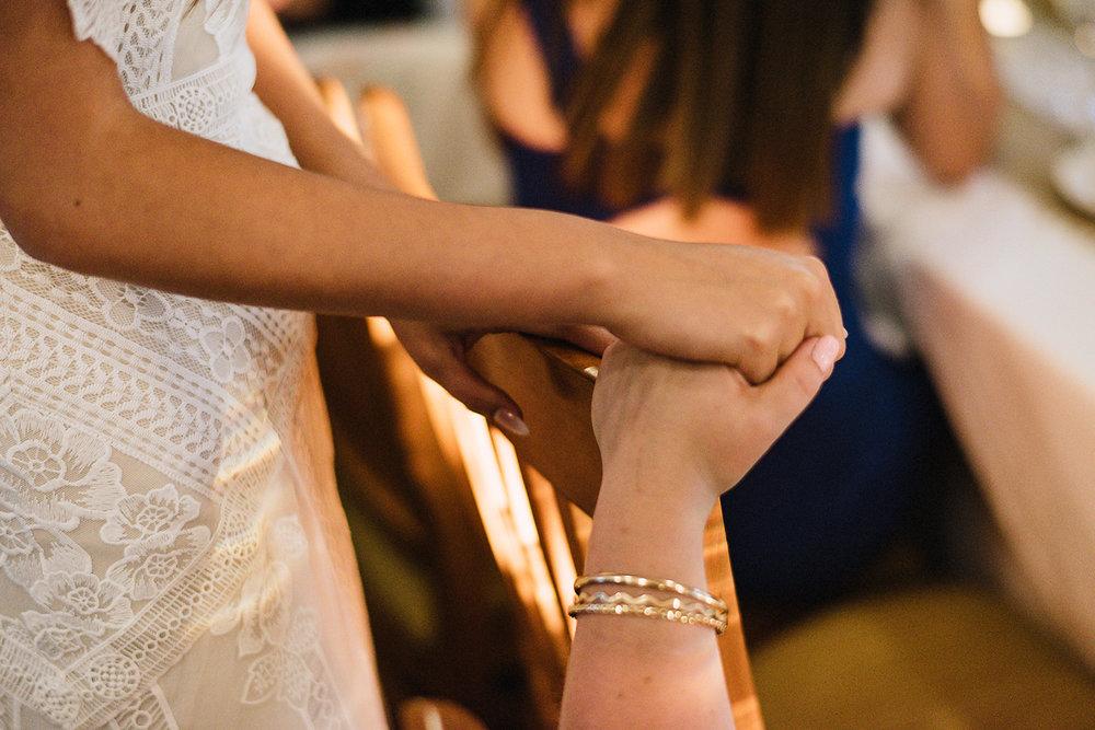 Muskoka-Cottage-Wedding-Photography-Photographer_Photojournalistic-Documentary-Wedding-Photography_Vintage-Bride-Lovers-Land-Dress_Nature_Film_Sherwood-Inn_Bride-hand-holding-detail.jpg