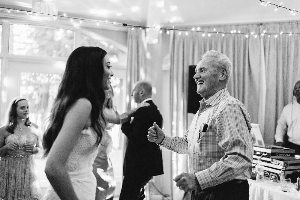 Muskoka-Cottage-Wedding-Photography-Photographer_Photojournalistic-Documentary-Wedding-Photography_Vintage-Bride-Lovers-Land-Dress_Boho-Bride-Wedding-Reception-Candid-Moment-with-grandfather.jpg
