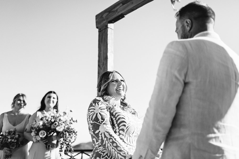 cabo-san-lucas-wedding-travelling-destination-wedding-photographer-toronto-wedding-photographers-3b-photography-hipster-trendy-documentary-style-mexico-wedding-ceremony-bride-and-groom-vows-ocean-view-cabo-bride-laughing-candid-emotional.jpg