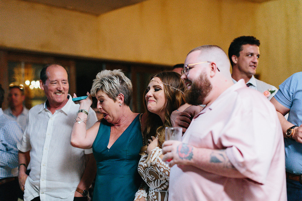 cabo-san-lucas-junebug-weddings-green-wedding-shoes-toronto-wedding-photographer-3b-photography-ventanas-private-club-mexico-reception-night-mother-and-son-first-dance-real-moments-bride-crying.jpg