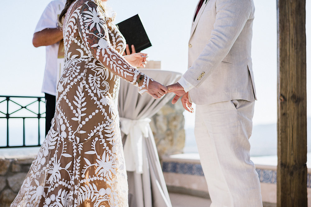 destination-wedding-cabo-san-lucas-ventanas-private-residence-alternative-toronto-wedding-photographer-ceremony-candid-documentary-moments-bride-and-groom-vows-holding-hands-details.jpg