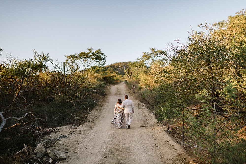 destination-wedding-cabo-san-lucas-ventanas-private-residence-alternative-toronto-wedding-photographer-documentary-photojournalistic-portraits-bride-and-groom-portraits-walking-away-sunset-desert.jpg
