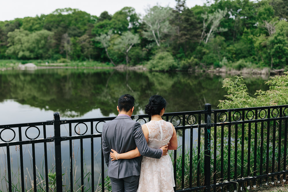 toronto-wedding-photographer-high-park-colborne-lodge-intimate-small-elopement-junebug-weddings-outdoor-wedding-bride-and-groom-portraits-cabin-cottage-like-vibes-greenery-forest-trees-couples-photos-duck-pond.jpg