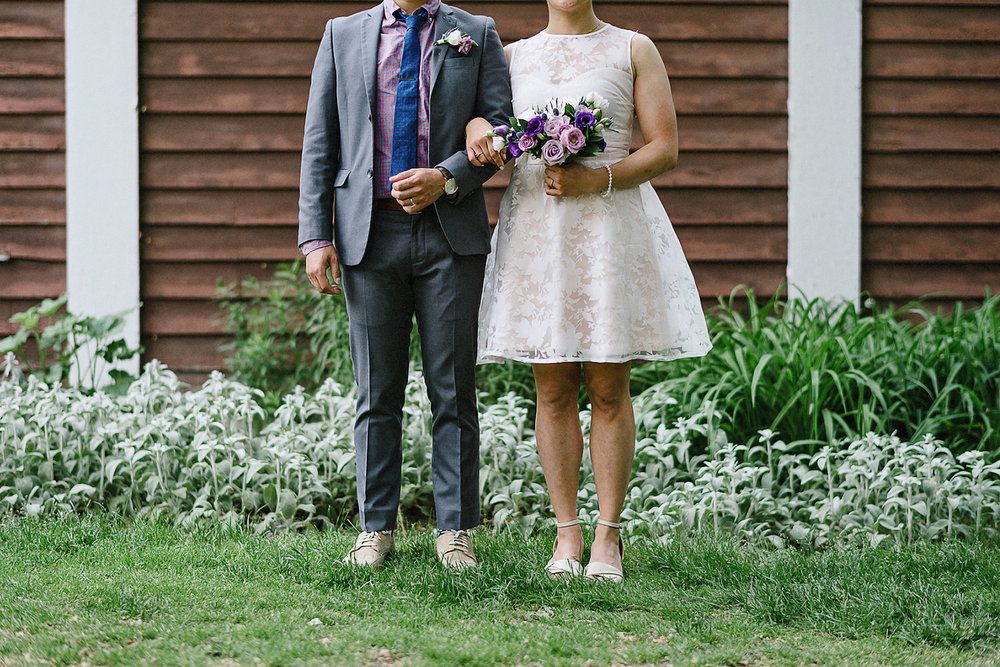 Best-documentary-wedding-photographers-Toronto-Mango-Studios-3B-photography-Junebug-Weddings-Bride-and-Groom-Walking-through-a-forest--american-gothic-style.jpg