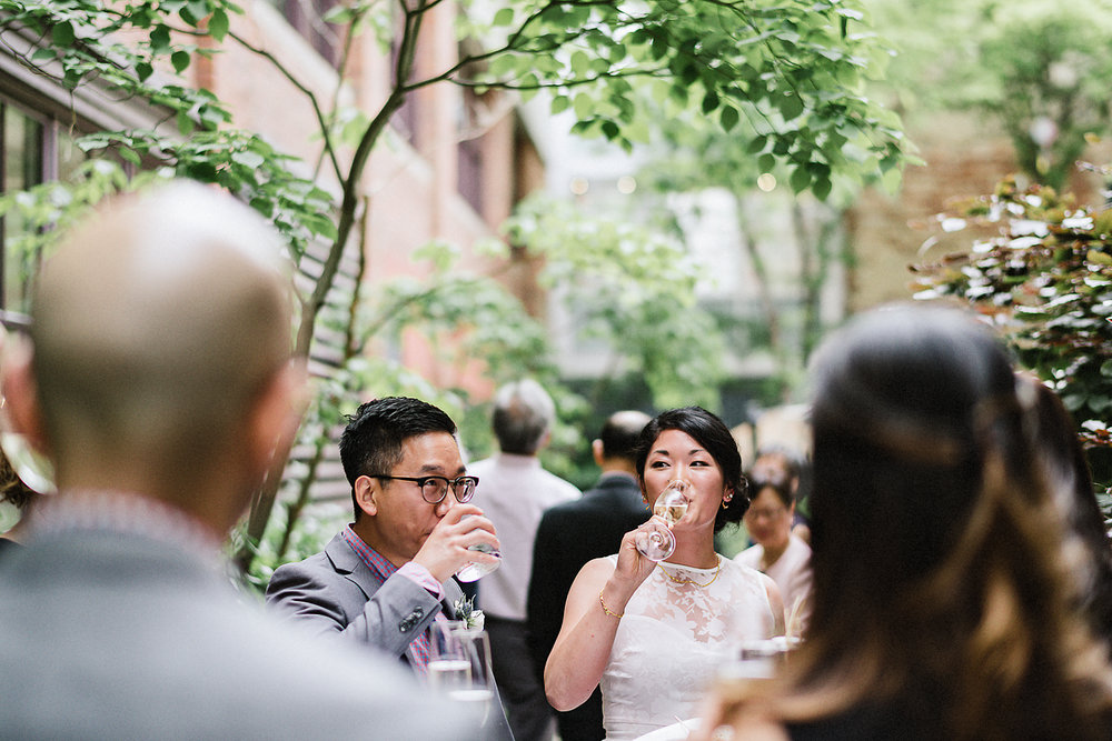 Best-Toronto-Wedding-Photographers_High-Park-Wedding_The-Lodge-Wedding_George-Restaurant-Reception_Analog-Film_Intimate-Candid-Photography_Guests-Detail_Outdoor-Summer-Wedding-Toronto_Restaurant-Bride-and-Groom-Candid.jpg