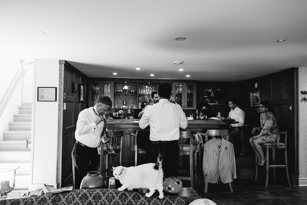 Mono-Cliffs-Inn-Wedding-Country-House-Farm-Ontario-Wedding-Photography-Vintage-Bride-and-Groom-Wedding-Inspo-Best-Toronto-Wedding-Photographer_Landscape-Scene-Setter_Groom-Getting-Ready-Natural-Light-Basement-Bar.jpg