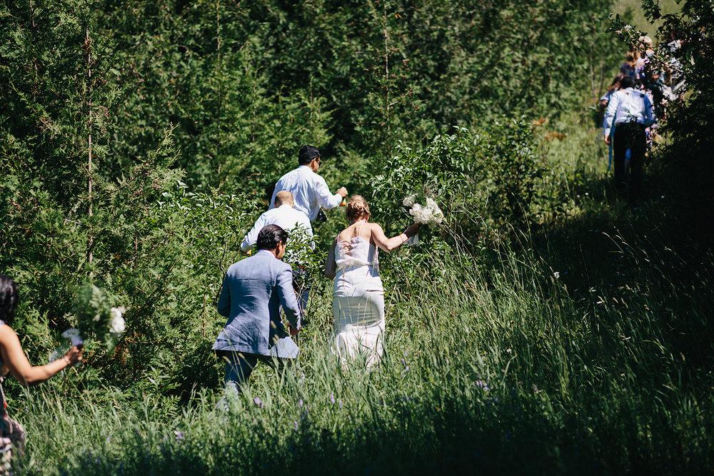 Best-Documentary-photojournalistic-wedding-photographers-Toronto-Ontario-Canada-Rural-Country-House-Backyard-Wedding-Vintage-childhood-home-climbing-huge-hill.jpg