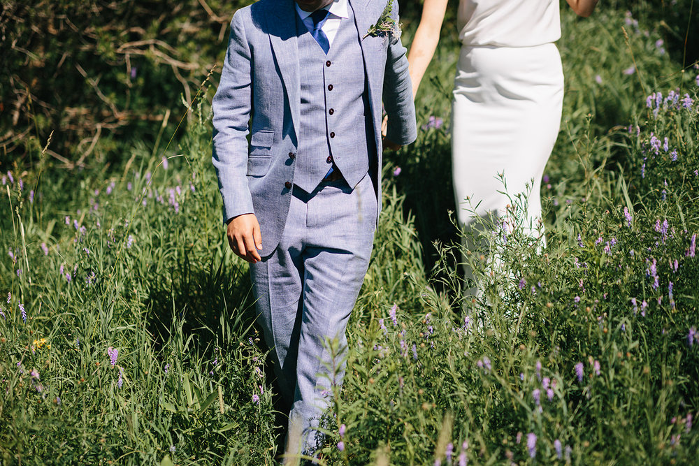 Best-Documentary-photojournalistic-wedding-photographers-Toronto-Ontario-Canada-Rural-Country-House-Backyard-Wedding-bride-and-groom-portraits-real-moments-intimate--epic-view-walking-down-hill-together-holding-hands.jpg