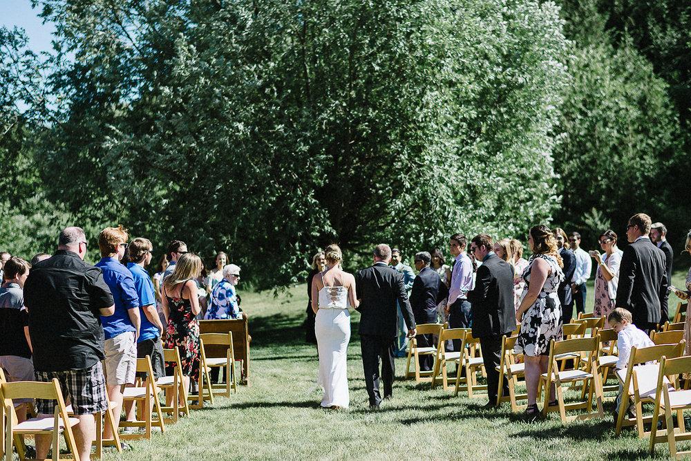 Best-Documentary-photojournalistic-wedding-photographers-Toronto-Ontario-Canada-Rural-Country-House-Backyard-Wedding-Vintage-Bride-walking-down-aisle.jpg