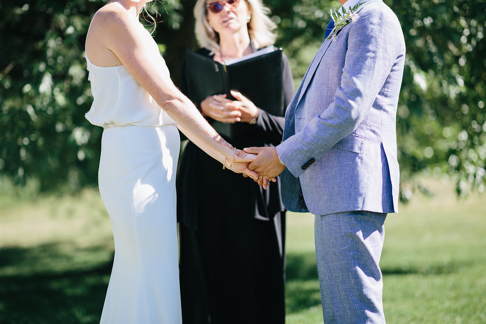 Best-Documentary-photojournalistic-wedding-photographers-Toronto-Ontario-Canada-Rural-Country-House-Backyard-Wedding-Ceremony-Vintage-aesthetic-bride-and-groom-exchanging-rings.jpg