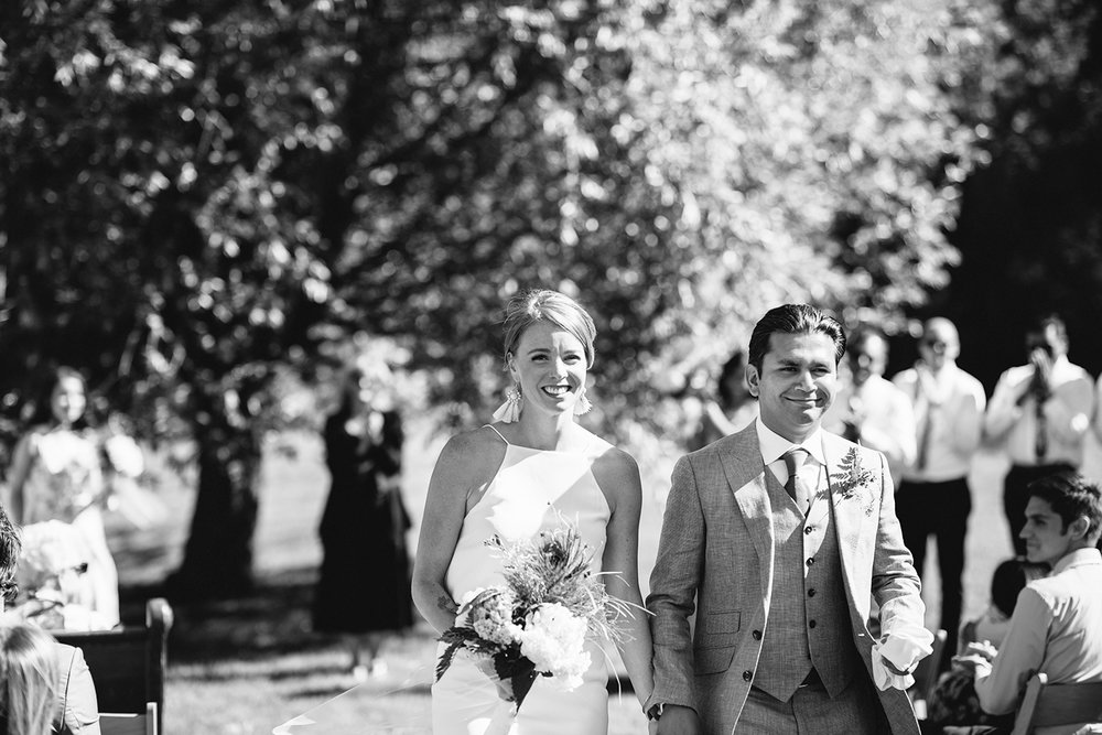 Best-Documentary-photojournalistic-wedding-photographers-Toronto-Ontario-Canada-Rural-Country-House-Backyard-Wedding-Ceremony-Vintage-aesthetic-bride-and-groom-just-married-walking-down-the-aisle-recessional.jpg