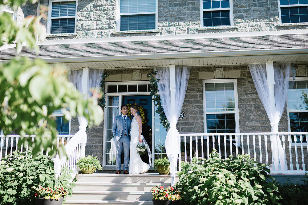 Best-Documentary-photojournalistic-wedding-photographers-Toronto-Ontario-Canada-Rural-Country-House-Backyard-Wedding-Ceremony-Vintage-Couple-Aesthetic-Bride-groom-candid-portrait-with-country-house.jpg