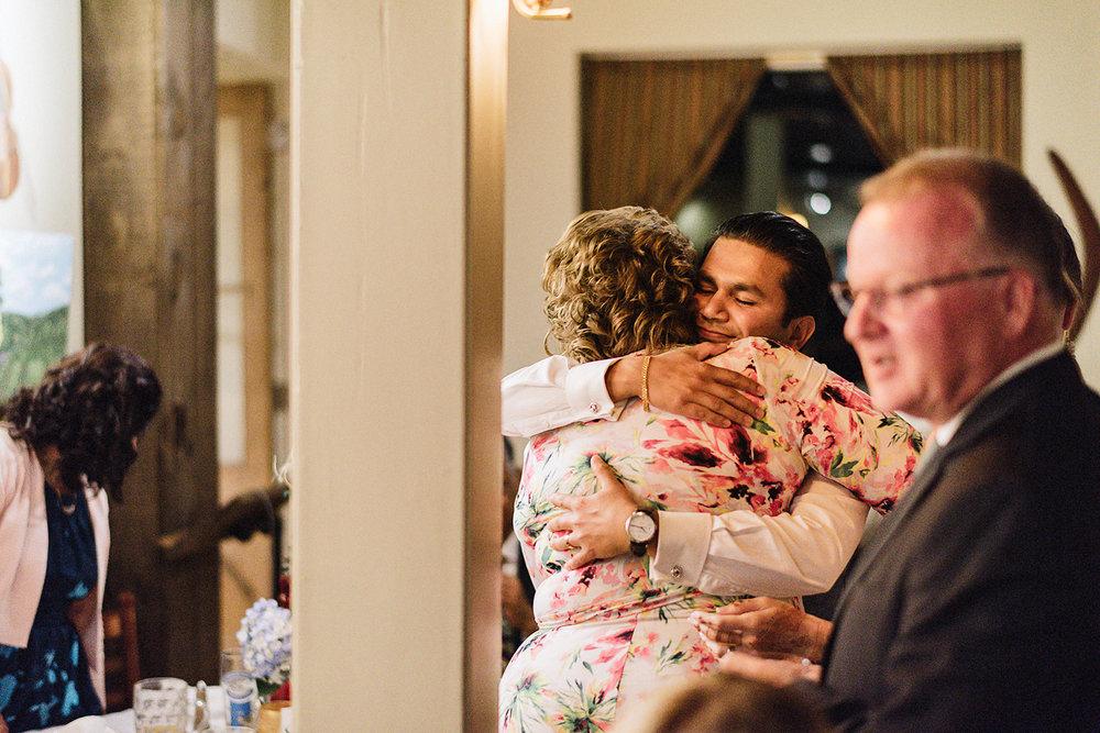 Toronto-Wedding-Photographers-3B-Photography-Vintage-Analog-Film-Aesthetic-Natural-Documentary-Photojournalistic-Wedding-Photography-Editorial-Timeless-Candid-Groom-Hugging-Mother-of-Bride.jpg