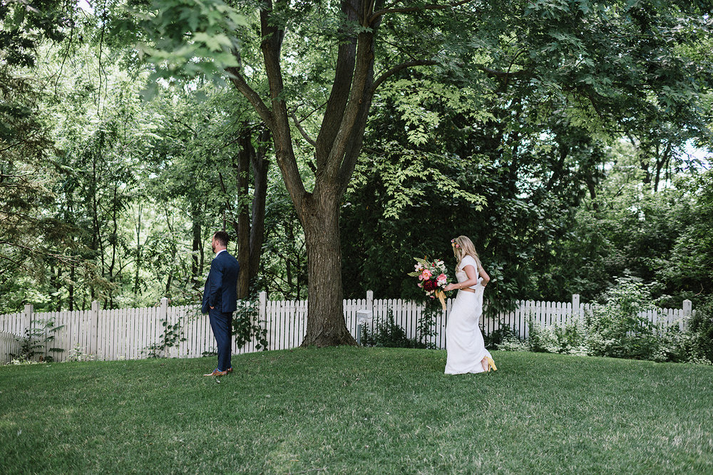 Boho-Bride-Aesthetic-Loversland-Two-Piece-Wedding-Dress-Bo-and-Luca-Isra-Dress-Summer-Wedding-Doctors-House-Best-Toronto-Wedding-Photographers-Vintage-Wedding-Bride-and-Groom-Forest-Portraits-First-Look-anticipation-under-willow-tree.jpg