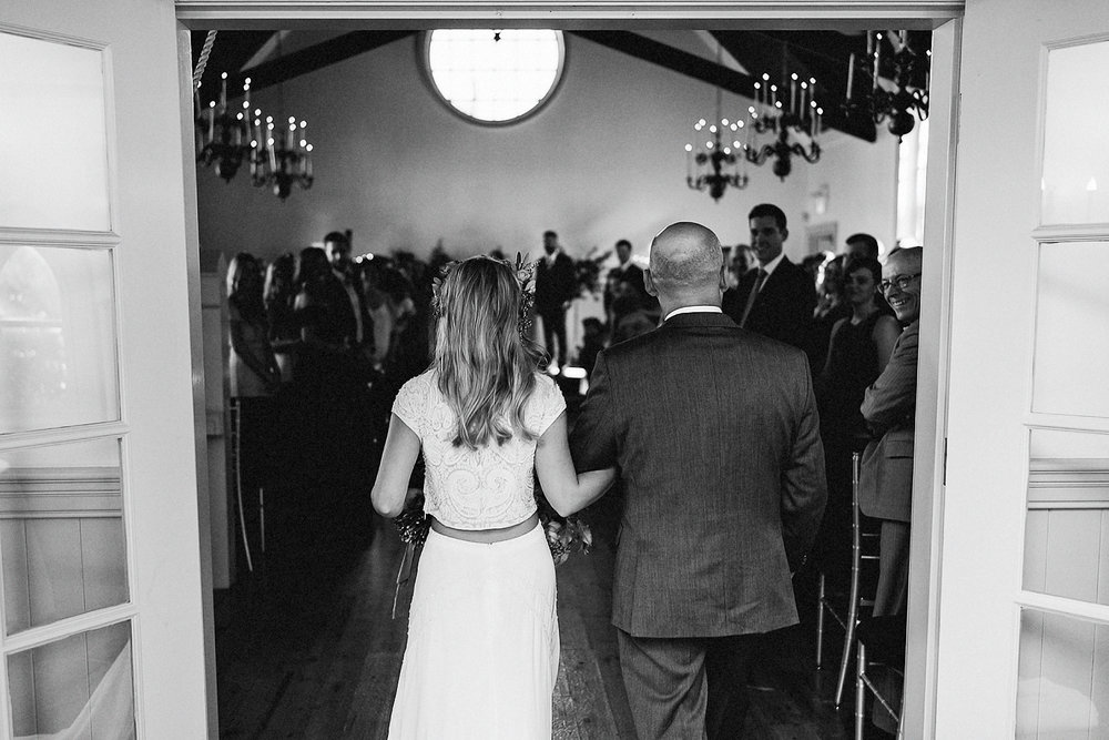 Best-Wedding-Venues-Toronto-Vintage-Country-Home-Doctors-House-Kleinburg-Analog-Film-Wedding-Photography-Best-Wedding-photographers-Toronto-3B-Photo-Ceremony-Entrance-Bride-and-Dad-POV-BW.jpg