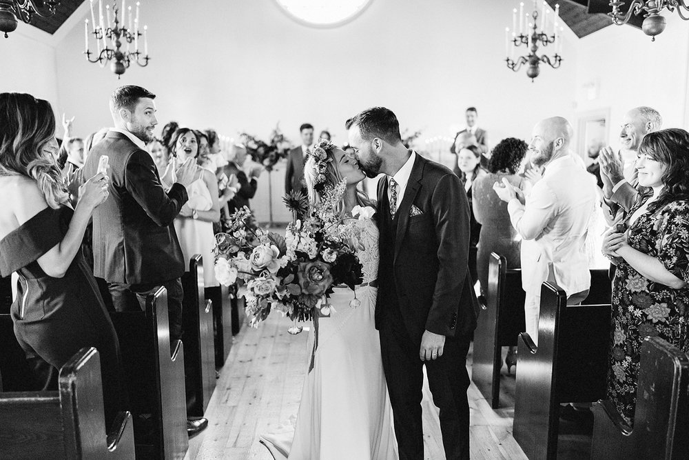 Best-Wedding-Venues-Toronto-Vintage-Country-Home-Doctors-House-Kleinburg-Analog-Film-Wedding-Photography-Best-Wedding-photographers-Toronto-3B-Photo-Ceremony-Vintage-Chapel-Bride-and-groom-exit-Kiss.jpg