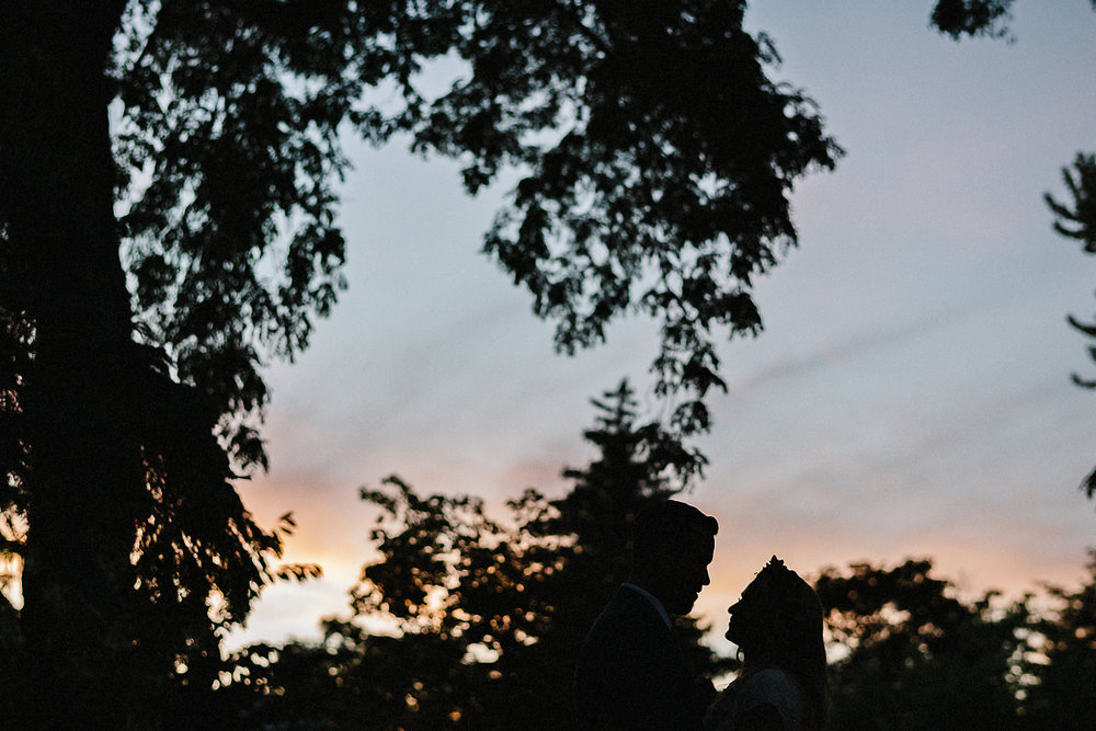 Best-Wedding-Venues-Toronto-Vintage-Country-Home-Doctors-House-Kleinburg-Analog-Film-Wedding-Photography-Best-Wedding-photographers-Toronto-3B-Photo-Bride-and-Groom-watching-Pink-Sunset-tree-details.jpg