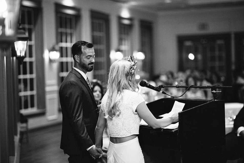 3b-photography-kleinberg-the-doctors-house-junebug-wedding-inspiration-large-wedding-reception-simple-modern-cool-speeches-bride-and-groom-cheers-bride-and-groom-speech-kissing.jpeg