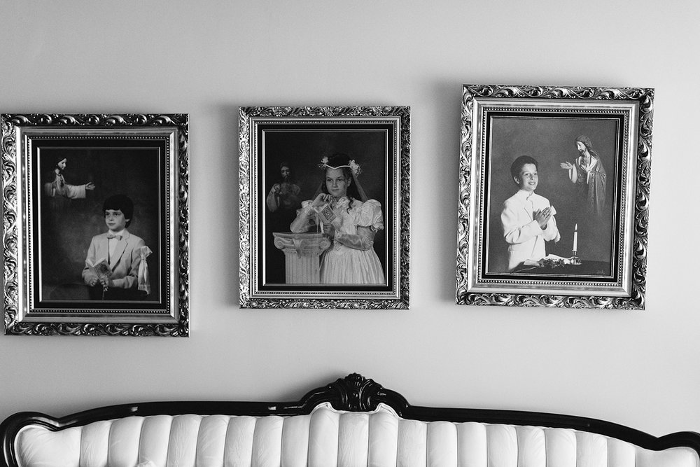 Liberty-Grand-Wedding-Best-Toronto-Wedding-Photographers-Analog-Film-Vintage-Bride-getting-ready-in-her-childhood-home-old-dinning-room-with-vintage-photographs-of-bride.jpg