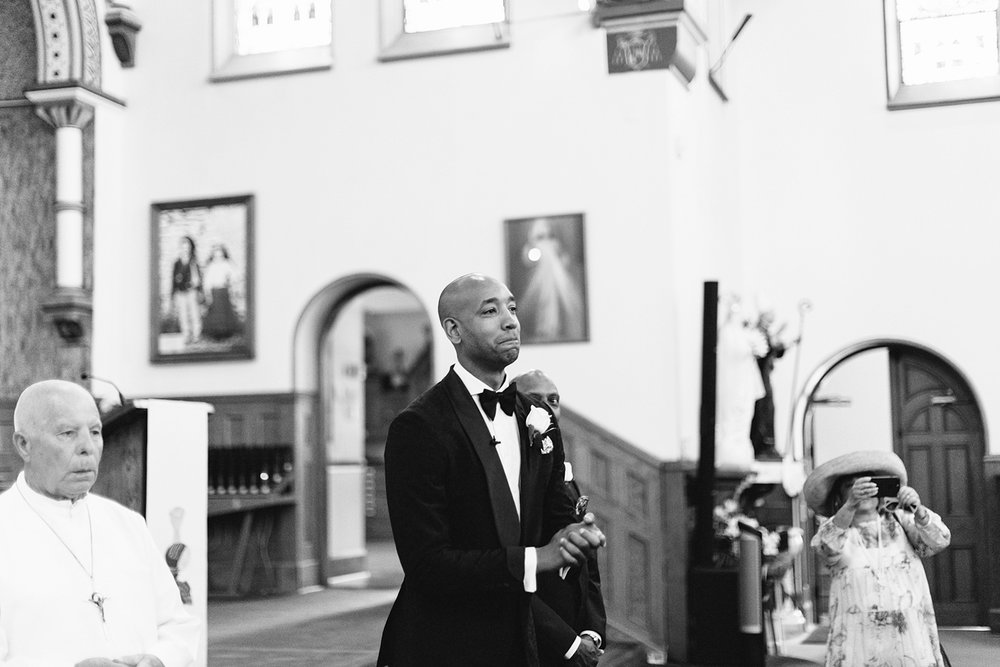 Church-Ceremony-downtown-toronto-bloor-west-Vintage-Wedding-Groom-and-Bride-Candid-Photojournalism-Documentary-Wedding-Photographers-Toronto-bride-walking-down-the-aisle-and-grooms-reaction-speechless.jpg