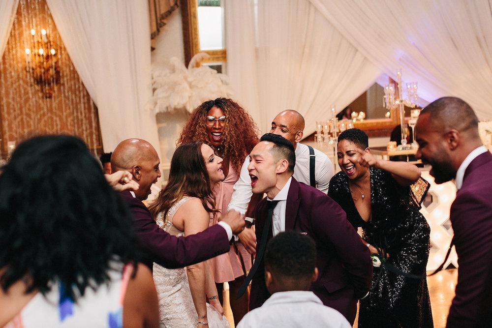 Best-Wedding-Venues-Toronto-Liberty-Grande-vintage-wedding-photography-toronto-bride-and-groom-wedding-photographer-reception-huge-party-bride-and-groomsmen-dancing.jpg