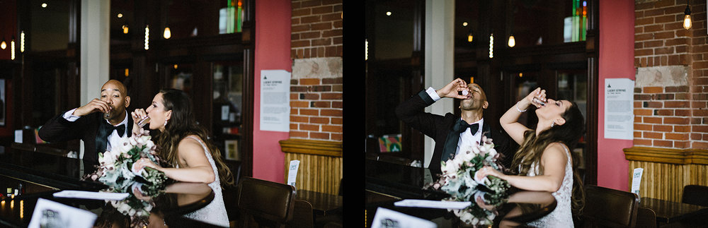 35Gladstone-Hotel-Bridal-Suit-Portrais-with-Vintage-Toronto-Bride-City-Urban-Wedding-Interracial-Couple-Vintage-Aesthetic-Window-Light-black-and-white-portraiture-intimate-candid-moment-documentary-photojournalism-couple-taking-a-shot-at-bar.jpg