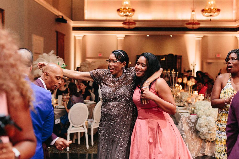 Best-Wedding-Venues-Toronto-Liberty-Grande-vintage-wedding-photography-toronto-bride-and-groom-wedding-photographer-reception-huge-party-grooms-mom-breaking-it-down.jpg