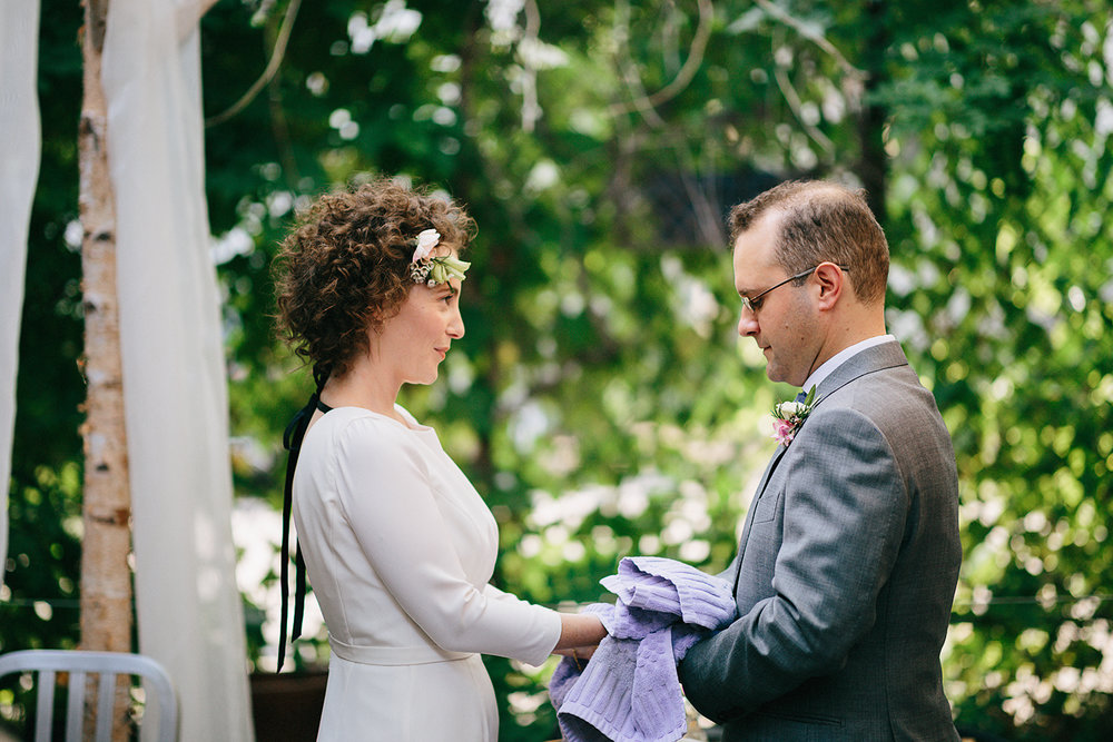 urban-downtown-toronto-wedding-fat-pasha-torontos-best-wedding-photographer-3b-photography-film-photographer-analog-photography-ceremony-on-outdoor-patio-jewish-ceremony-vows-washing-hands.jpg