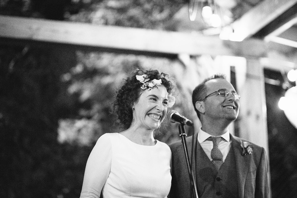 urban-downtown-toronto-wedding-fat-pasha-torontos-best-wedding-photographer-3b-photography-film-photographer-analog-photography-kodak-portra-800-outdoor-patio-string-lights-speeches-bride-and-groom-laughing.jpg