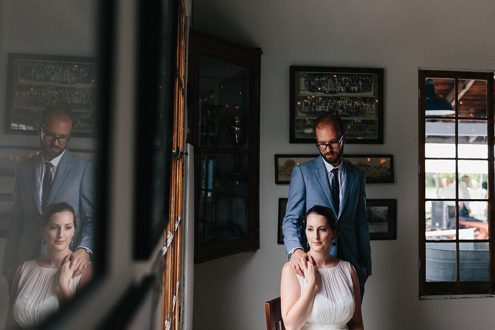 Toronto-Island-Wedding-Toronto-Best-Film-Wedding-Photographers-3b-photography-analog-photography-wards-island-clubhouse-details-old-photographs-vintage-rustic-venue-bride-and-groom-formal-portrait-moody-romantic-film-reflection.jpg