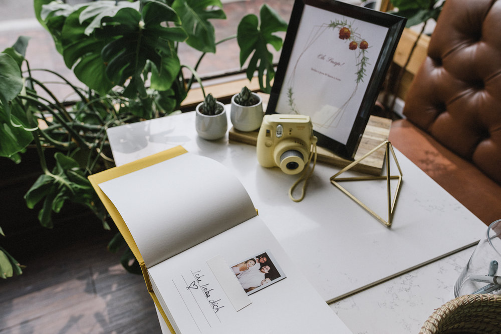 film-analog-photography-toronto-film-wedding-photographers-alternative-reception-bar-pray-tell-cocktail-hour-details-polaroid-guestbook.jpg
