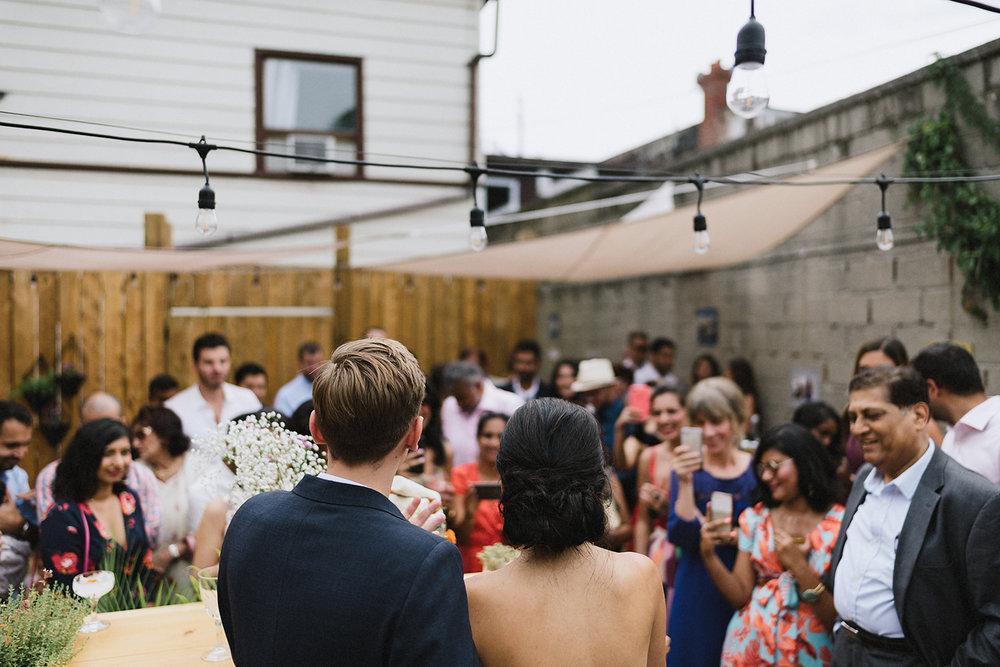 urban-downtown-toronto-wedding-fat-pasha-torontos-best-wedding-photographer-3b-photography-film-photographer-analog-photography-ceremony-on-outdoor-patio-jewish-ceremony-bride-and-groom-celebrating.jpg