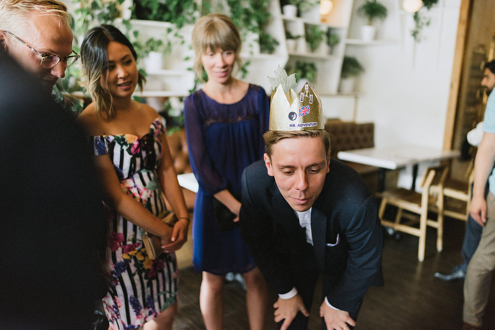 film-analog-photography-toronto-wedding-photographers-alternative-reception-bar-pray-tell-cocktail-hour-groom-crown-hilarious.jpg