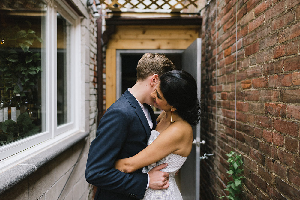 7-urban-downtown-toronto-wedding-fat-pasha-torontos-best-wedding-photographer-3b-photography-film-photographer-analog-photography-outdoor-patio-cocktail-hour-gold-hour-sunset-restaurant-and-bikes-sun.jpg