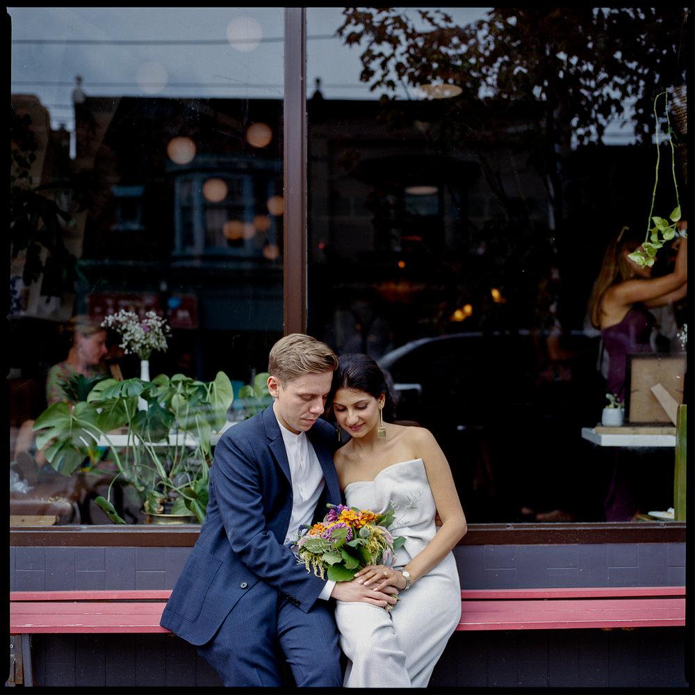 urban-downtown-toronto-wedding-fat-pasha-torontos-best-wedding-photographer-3b-photography-film-photographer-analog-photography-outdoor-patio-cocktail-hour-portraits-of-bride-and-groom-in-entrance-golden-hour-intimate.jpg
