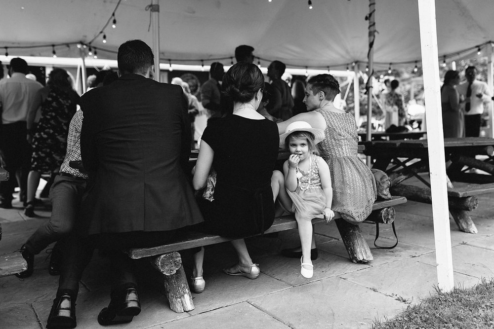 Toronto-Island-Wedding-Toronto-Best-Film-Wedding-Photographers-3b-photography-analog-photography-wards-island-clubhouse-junebug-weddings-vintage-venue-reception-cocktail-hour-candid-guests-mingling-eating-little-girl.jpg