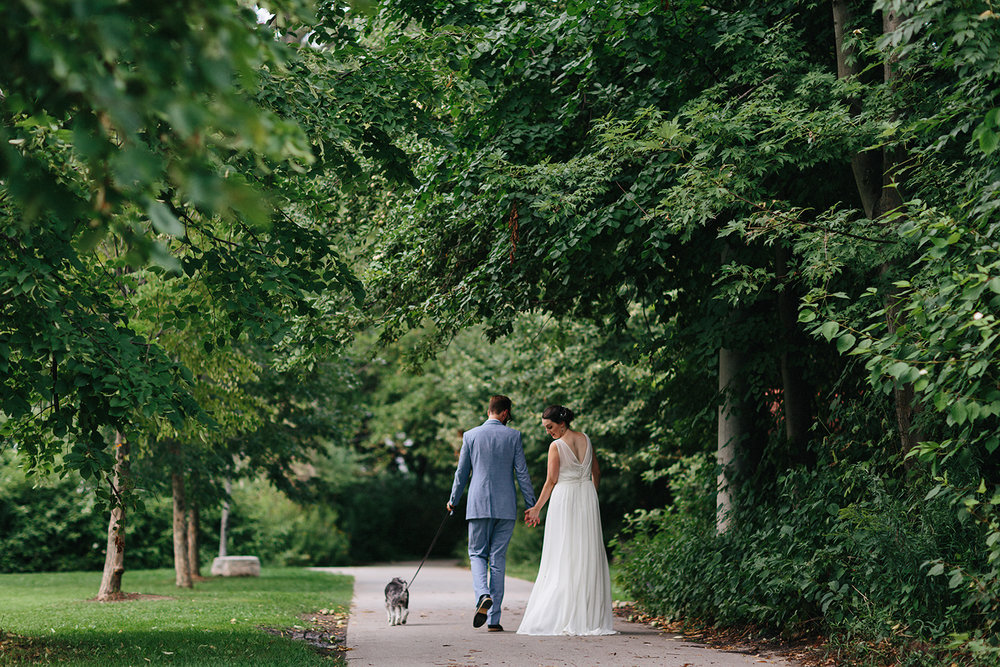 Toronto-Island-Wedding-Toronto-Best-Film-Wedding-Photographers-3b-photography-analog-photography-wards-island-clubhouse-junebug-weddings-vintage-venue-reception-couples-portraits-walking-away-with-terrier-otto.jpg