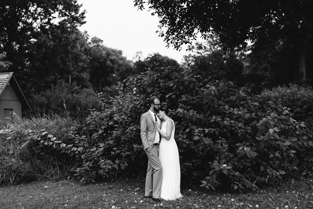 Toronto-Island-Wedding-Toronto-Best-Film-Wedding-Photographers-3b-photography-analog-photography-wards-island-clubhouse-junebug-weddings-vintage-venue-reception-bride-and-groom-sunset-portraits-on-film-kodak-tri-x-400-apple-tree.jpg