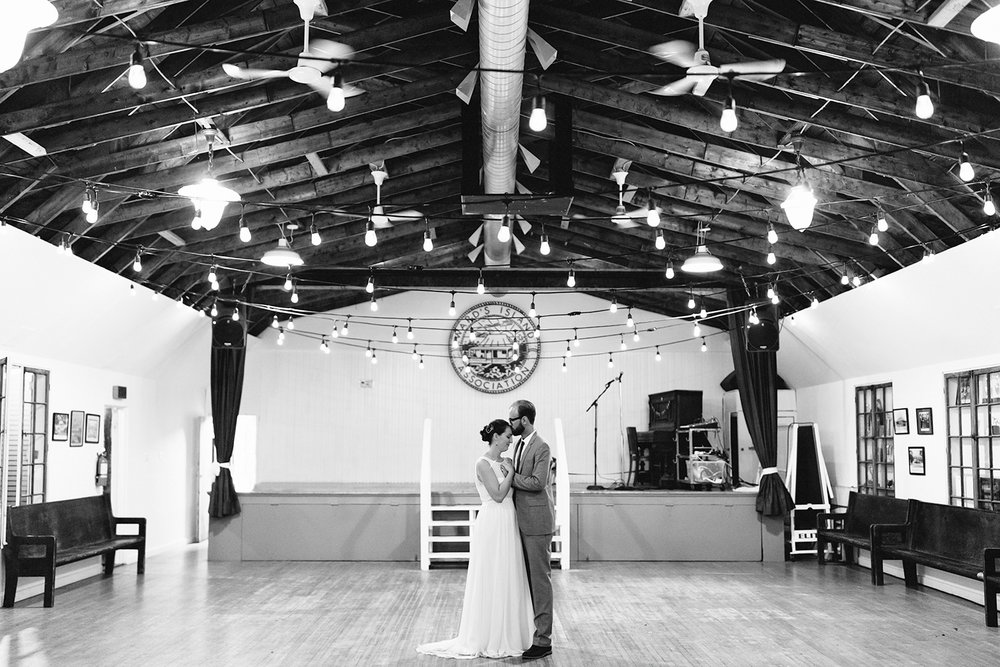 Best-Film-Wedding-Photographers-3b-photography-analog-photography-wards-island-clubhouse-junebug-weddings-vintage-venue-reception-guests-speeches-candid-moments-memories-bride-and-groom-intimate-romantic-dancing-in-the-gym-dog-bw.jpg